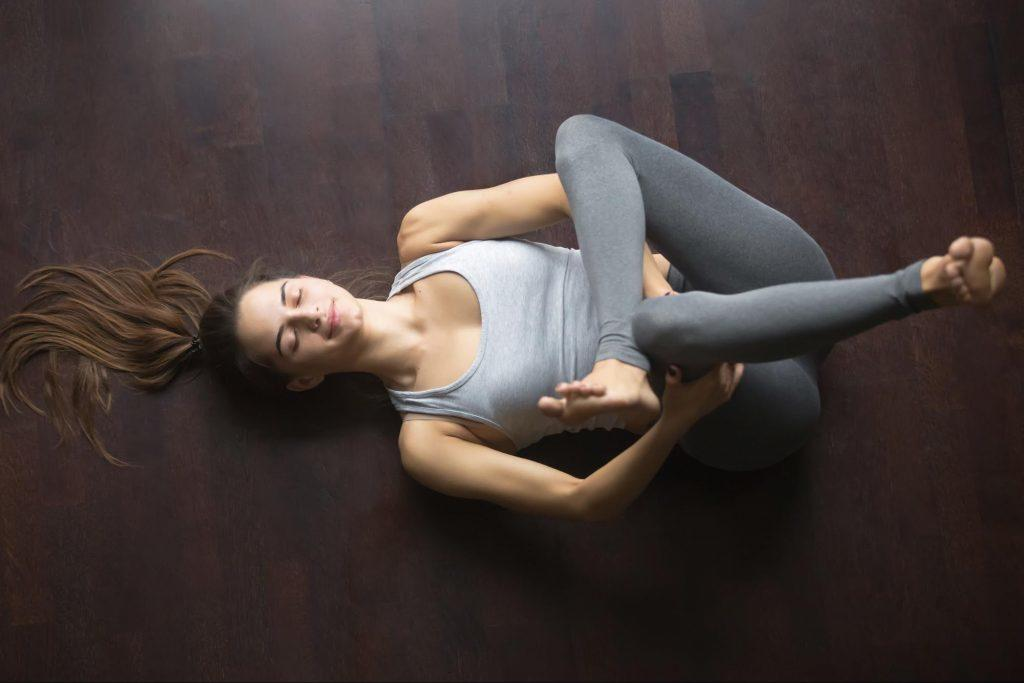 girl lying on the floor stretching