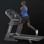 A man in athletic attire running on the Horizon 7.4 AT treadmill
