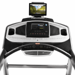 Console of the ProForm Smart Power 1295i Treadmill. This features a digital screen of a nature setting, 2 speakers, 2 cup holders, a fan and several buttons