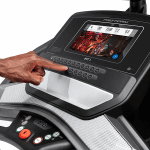 Console of the ProForm Smart Performance 400i Treadmill. This features a digital screen of worksout being conducted and several buttons