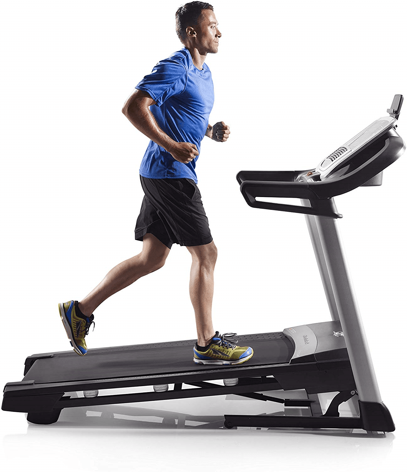 A fit man in athletic attire running on the C 700 treadmill