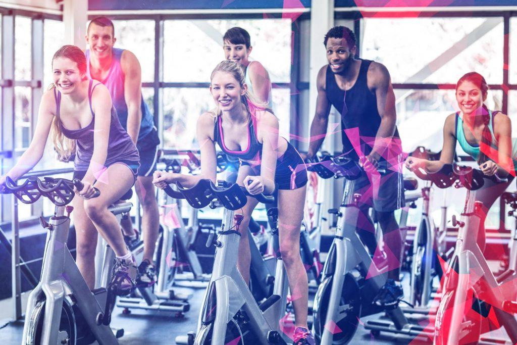 A group of people on exercise bikes