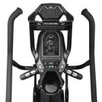 Console of the Bowflex Max Trainer M8. The trainer includes a cup holder, a fan, a speaker, a tablet holder and several buttons
