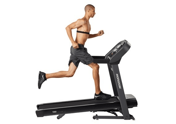 A fit man in athletic attire running on the Horizon T202 Treadmill