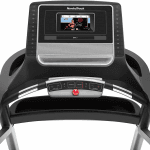 Console screen of the Nordictrack T 7.5 S treadmill with an image of a woman leading a workout. The treadmill features 2 cup holders, several buttons and a speaker