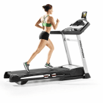 A woman in athletic attire running on the ProForm Smart Power 1295i Treadmill