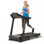 A fit woman in athletic attire running on the Horizon Adventure 3 Treadmill