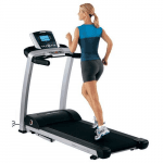 A fit woman in athletic attire running on the Life Fitness F3 Treadmill