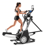 A fit woman in athletic attire working out on the FS9i Trainer