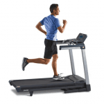A man in athletic attire running on the LifeSpan TR4000i treadmill