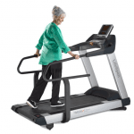 An elderly woman in casual attire walking on the TR8000i Treadmill