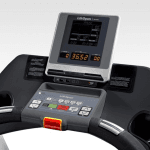 An image of the TR7000i console. This features 2 cup holders, a tablet holder, a digital screen, several buttons and a charging plug in